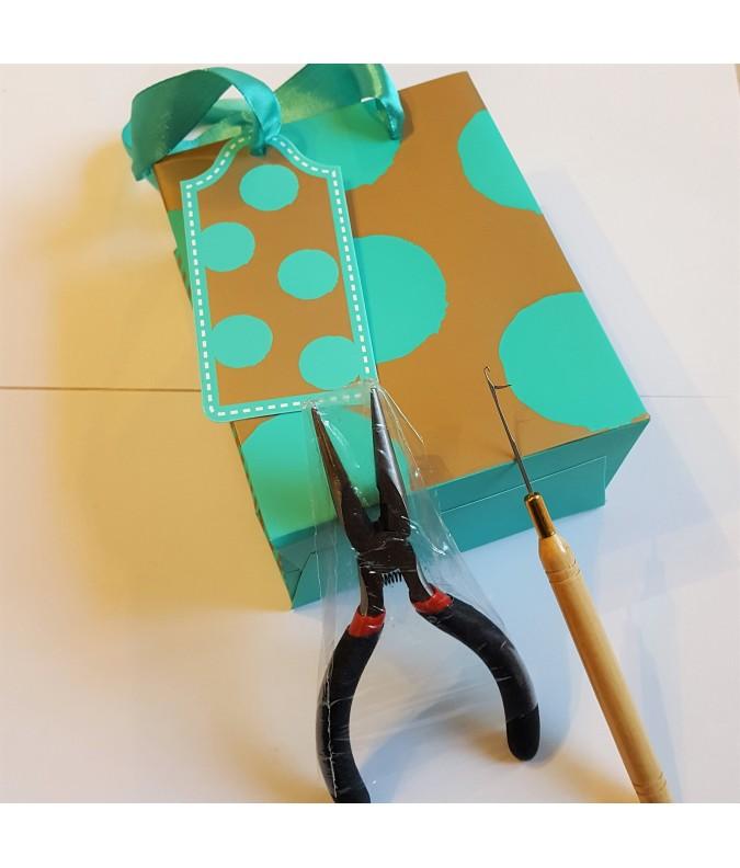 Petit sac cadeau funky avec outils et notice